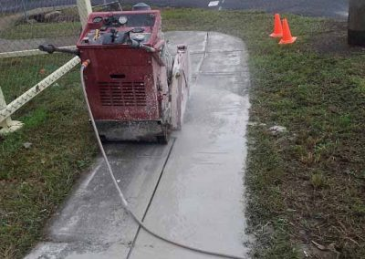 Cut It Out Concrete Sawing & Core Drilling -Concrete-Cutter Machine on the Pavement
