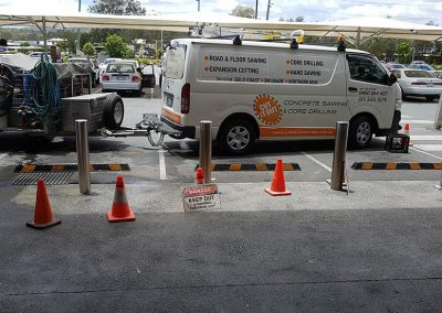 Cut It Out Concrete - bollards installation in front of shop