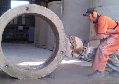 Cut It Out Concrete - man cutting a concrete tube